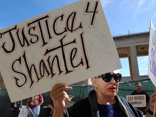 Theresa Gonzales, Shantel Llamas' aunt, speaks to the media and holds posters outside the Monterey County Superior Court in 2017.