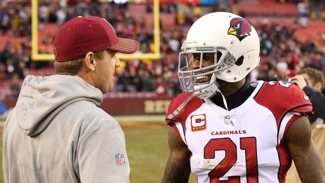 Washington Redskins head coach Jay Gruden shakes hands with Arizona Cardinals cornerback Patrick Peterson (21) after their game at FedEx Field. The Redskins won 20-15.