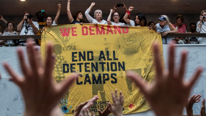 Hundreds of activists protest the Trump Administration's approach to illegal border crossings and separation of children from immigrant parents, in the Hart Senate Office Building on Capitol Hill in Washington on Thursday.