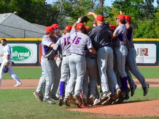 Utica Unicorns celebrate their win Sunday afternoon.