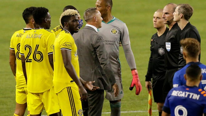 Columbus Crew manager Caleb Porter argues with officials after the final whistle in the second half of the MLS match between the FC Cincinnati and the Columbus Crew at Nippert Stadium in Cincinnati on Saturday, Aug. 29, 2020. The annual Hell is Real Derby finished in a 0-0 tie.