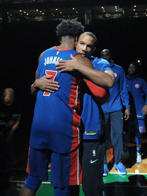 Pistons guard Avery Bradley, right, and Stanley Johnson hug before the Pistons' 118-108 win on Nov. 27, 2017 in Boston.