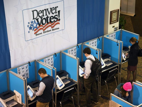 Coloradans vote at a polling location in Denver, where