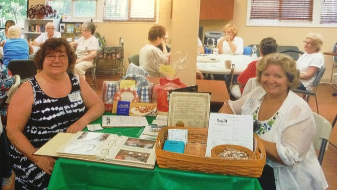 Millville Woman's Club President Linda Green (left) and Treasurer Kathryn Rockwell attend a health fair this month at Holly City Regional Senior Center. They spoke with attendees about the club and its community service activities.