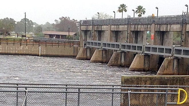 Water rushes through the gates on the Caloosahatchee River at the Franklin locks in Olga.