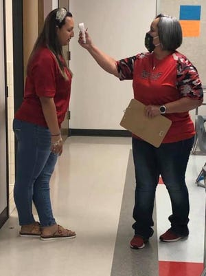 Premon ISD staff checked temperatures of staff and children during summer school. They will continue to take safety precaution as they prepare for another school year.