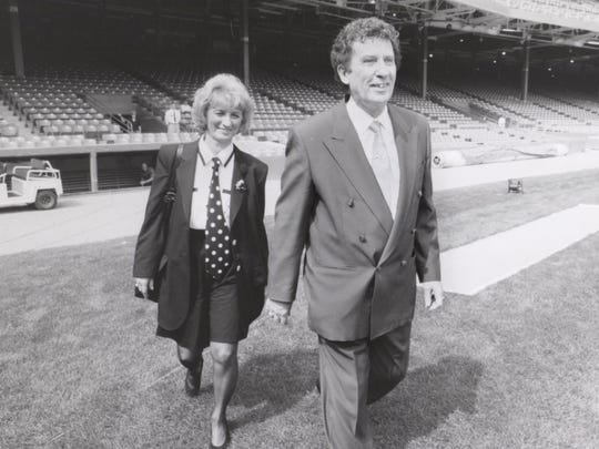 Owners Mike and Marian Ilitch walking onto the field
