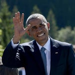 President  Obama waves as he is welcomed by German Chancellor Angela Merkel upon arrival at a breakfast meeting with local citizens in Kruen near Garmisch-Partenkirchen, southern Germany, on June 7, 2015 before the start of a G-7 summit.