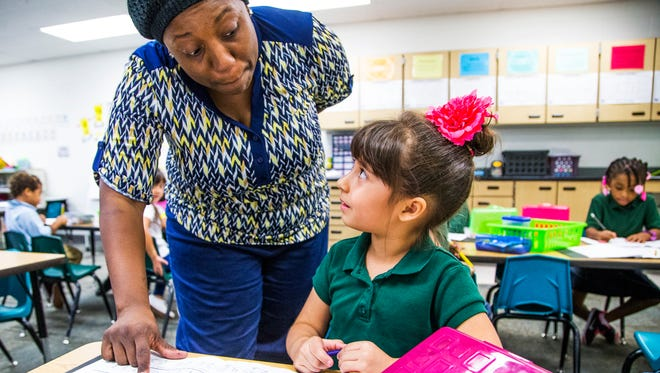 Sheely Farms Elementary School kindergarten teacher Tamara Jackson  helps Sophia Chavez, 5, in class on Oct. 27, 2016. The Tolleson Elementary district passed an override for the 2012-13 school year to fund full-day kindergarten. It is up for renewal again this year.