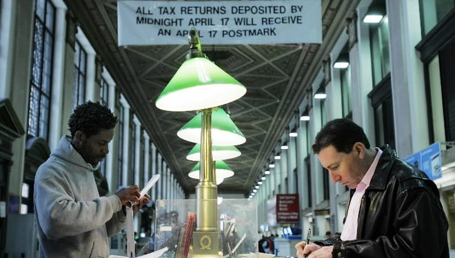 New Yorkers prepare tax forms for mailing in 2007 in New York.