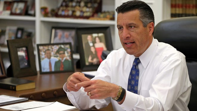 Nevada Gov. Brian Sandoval sits in his office at the Capitol in Carson City.