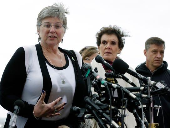 Boston Marathon bombing survivor Karen Brassard, left,