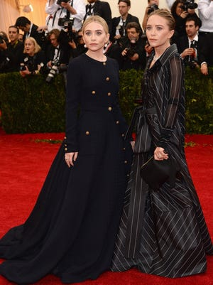 "Ashley Olsen and Mary-Kate Olsen attend the ""Charles James: Beyond Fashion"" Costume Institute Gala at the Metropolitan Museum of Art on May 5, 2014, in New York City."