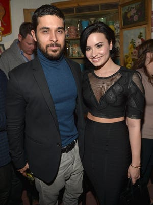 """Wilmer Valderrama and Demi Lovato celebrate Nick Jonas' song """"Jealous"""" being the #1 At Top 40 radio hit at The Ivy on January 20, 2015 in Los Angeles, United States."""