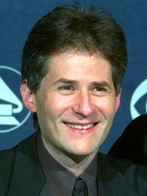 """Composer James Horner poses for a photo at the 41st Annual Grammy Awards at the Shrine Auditorium in Los Angeles on Feb. 24, 1999. Horner's agent says the Oscar-winning """"Titanic"""" composer was the pilot who died in a Southern California plane crash Monday, June 22, 2015. He was 61."""