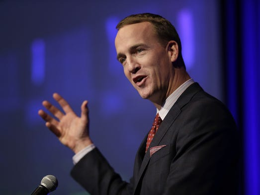 Former Indianapolis Colts Peyton Manning talks to the