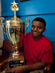 "Franklin ""Kinte"" Gilbert, winner of the Boys and Girls Club of America New Mexico Youth of the Year Award, poses for a photo while holding his award, June 15, 2016."