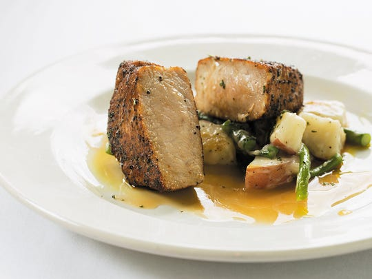 The coffee-rubbed pork, which was lying atop the potatoes, was tender and flavorful.