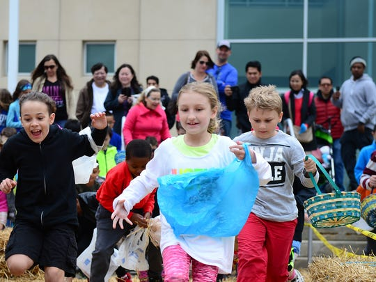 Kids participate in the easter egg hunt during Easter