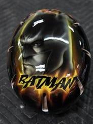 A custom painted Batman helmet done by Springfield-based