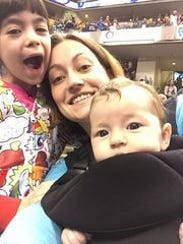 Megan Woodward, shown here with her own children.