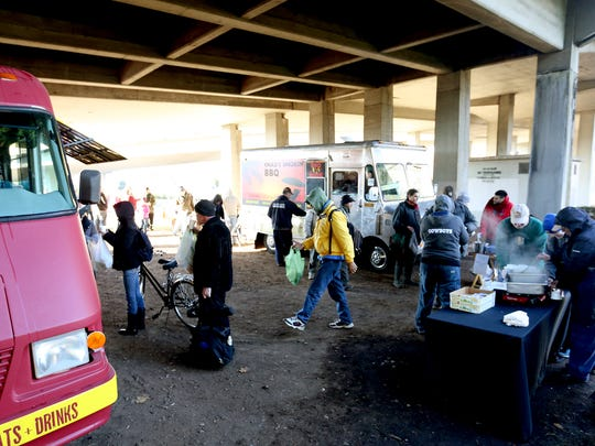 The Feed the Need event under the Marion Street Bridge in Salem on Thursday, Nov. 26, 2015. Local food trucks and other volunteers gave full to-go Thanksgiving meals for 150 people.