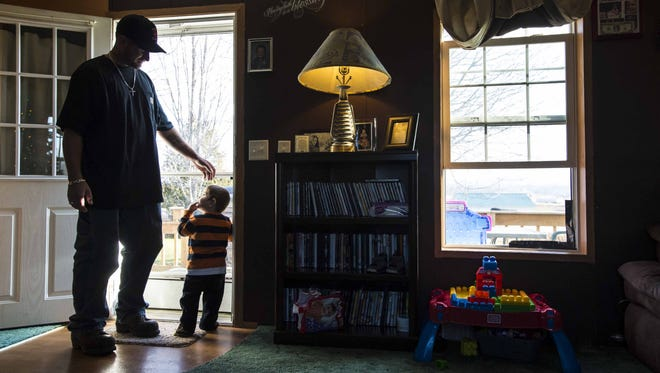 Ryan Trombley and his son Kayde at home in St. Albans Town on Thursday, December 10, 2015. Kayde has recently received a kidney transplant.  Trombley and his wife Tanyiel Begnoche are losing their local pediatrician, in part because of the low rate of Medicaid reimbursements. Four of eleven pediatricians in Franklin County are leaving their practices.