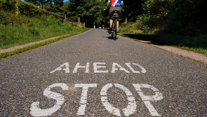 A cyclist rides along the Burlington bike path between North Beach and Leddy Park on Tuesday, September 6, 2016.