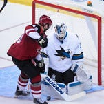 Oct. 2, 2015; Glendale; San Jose Sharks goalie Martin Jones (31) makes a save on Arizona Coyotes left wing Jordan Martinook (48) during the third period at Gila River Arena.