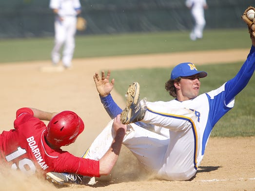 Nicholas Boardman (19) of La Salle is tagged out at third by Moeller's Cole Proia.
