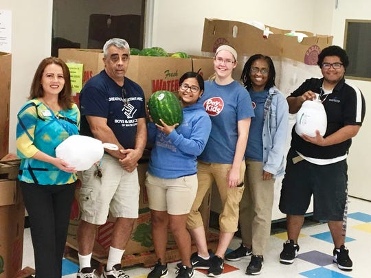 In addition to turkeys and other traditional holiday foods, families received fresh produce, including watermelon at a recent Mobile Pantry distribution.