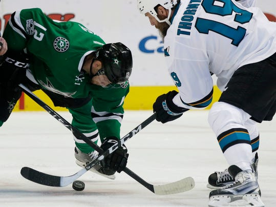 San Jose Sharks center Joe Thornton (19) and Dallas Stars center Radek Faksa (12) vie for the puck on the face-off during the first period of an NHL hockey game in Dallas, Monday, March 20, 2017. (AP Photo/LM Otero)