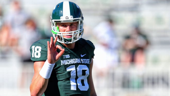 Michigan State Spartans quarterback Connor Cook (18) gestures from the field prior to the game against the Wyoming Cowboys.