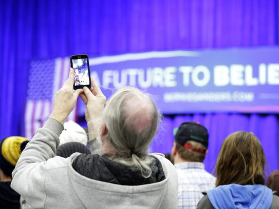 Phones capture the moment as the crowd waits for Democratic