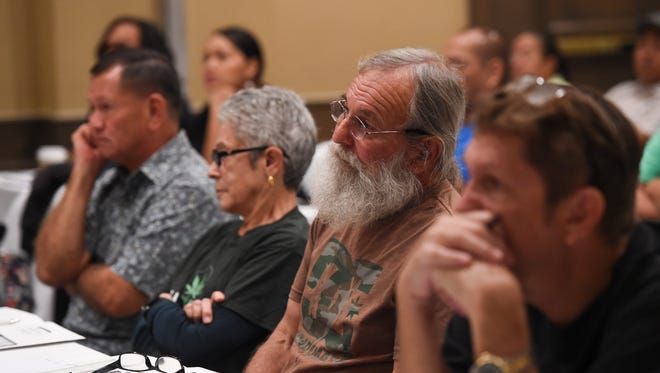 Event attendees listen to a presentation given by guest speaker Nic Easley, the 3C Comprehensive Cannabis Consultation chief executive officer, during Grassroots Guam's medical cannabis patient workshop at Hyatt Regency Guam in Tumon on Jan. 21, 2017.