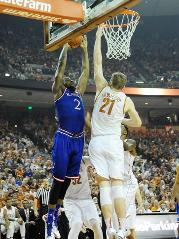 Kansas Jayhawks forward Cliff Alexander takes it to