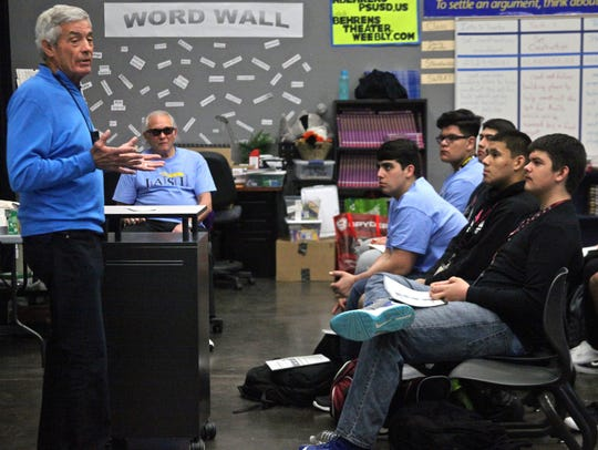 Former NFL coach Jim Mora talks to students of the