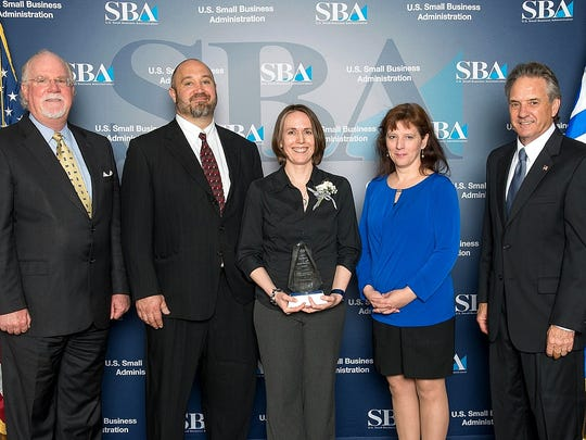 The Elmira Gymnastics Club and Fitness Center was recently honored with a Small Business Excellence Award. From left, Patrick MacKrell, from New York Business Development Center; fitness center owners  Marc and Laura Monichetti; Sherri Arnold, of New York Small Business Development Center Corning; and Bernard J. Paprocki, from the U.S. Small Business Administration.