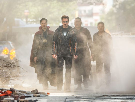 Tony Stark (Robert Downey Jr., front) heads up a crew