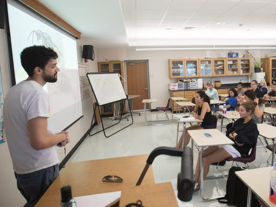 Students in a General Biology II class at Florida Gulf Coast University listen to a lecture by graduate student, Santiago Luaces on Friday. FGCU is lacking in class space especially in the labs.