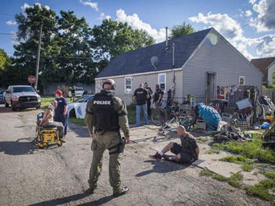 Three people were arrested in a meth raid at 1100 W.