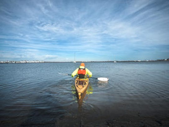 Denis Carmody paddles away in waters of Cape May. Carmody,