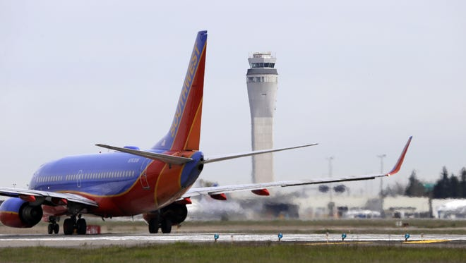 This photo taken April 23, 2013 shows a Southwest airlines jet waiting to depart in view of the air traffic control tower at Seattle-Tacoma International Airport in Seattle.