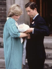 Charles and Diana introduce Prince William to the world