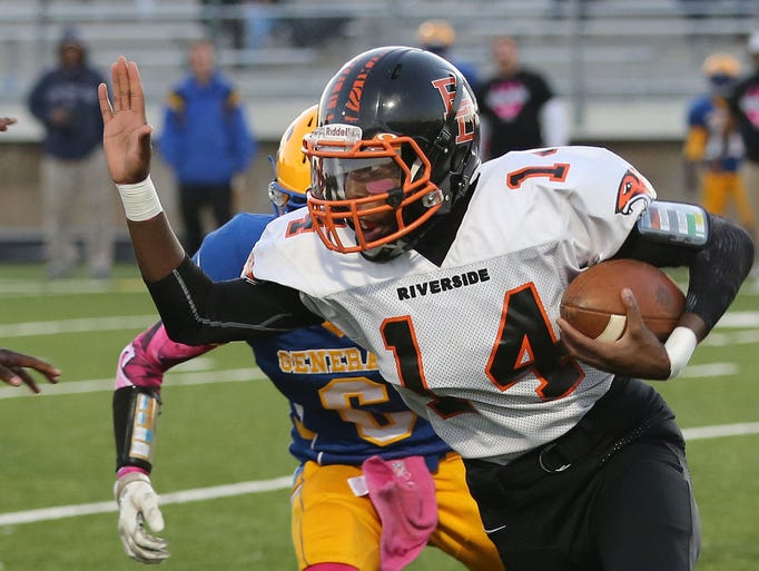 Riverside's Gerron Moss fends off a tackle from Kings'