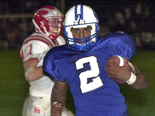 Oak Creek's Brian Calhoun was our All-Suburban Player of the Year in football in 2000.