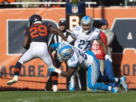 Tahir Whitehead tackles the Chicago Bears' Tarik Cohen in the first quarter of the Detroit Lions' 27-24 win Sunday, Nov. 19, 2017 at Soldier Field in Chicago.