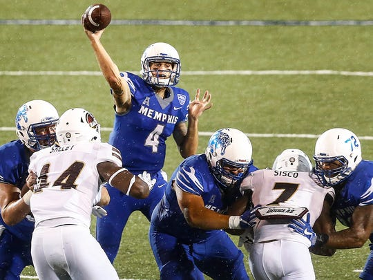University of Memphis quarterback Riley Ferguson (top) makes a pass against the University of Louisiana-Monroe defense during second quarter action at the Liberty Bowl Memorial Stadium.