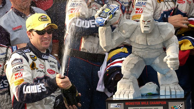 Jimmie Johnson celebrates after winning the MBNA 400 in September 2005, one of his eight victories at Dover International Speedway.