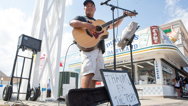 Alex W. Young of North Carolina performs along the Boardwalk at the end of Caroline Street in Ocean City. Young has been performing county and classic rock covers in Ocean City since 2012.